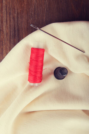 sewing supplies: Ivory fabric and sewing supplies Stock Photo