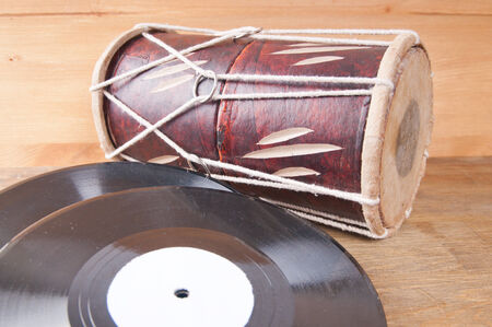 darbuka: Vintage  drum and vinyl record on a wooden