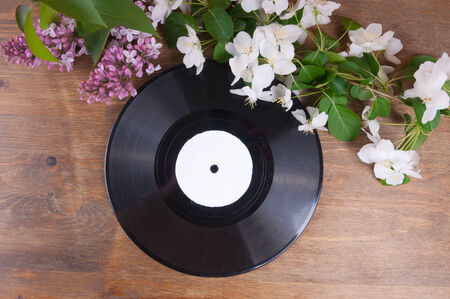 Vinyl record and spring flowers on the table photo