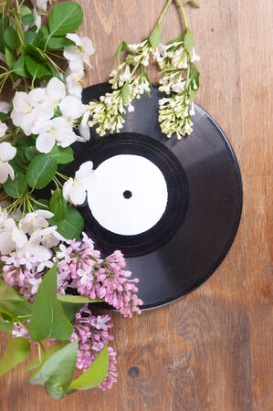 Vinyl record and spring flowers on the table