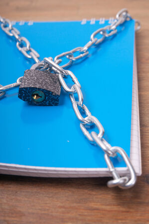 Blue notebook, tied with chains with lock, the concept of information security photo