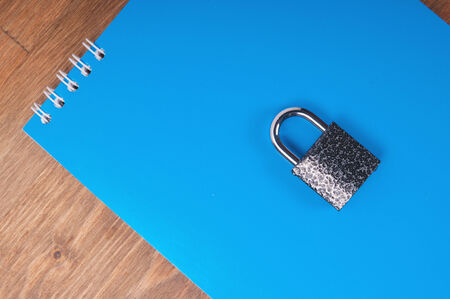 Blue notebook with lock, concept of data security photo