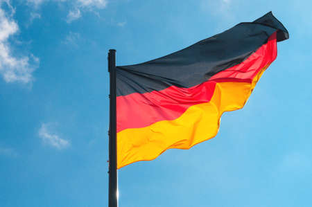 German flag on a background of the sky photo