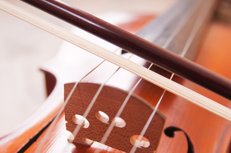 Violin and bow on a wooden table