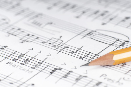 sheet music: Sheet sheet and pencil, shallow DOF