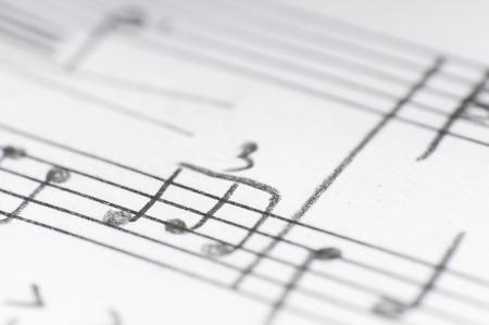 paper sheet: Handwritten musical notes, shallow DOF Stock Photo