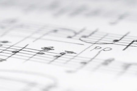 music abstract: Handwritten musical notes, shallow DOF Stock Photo