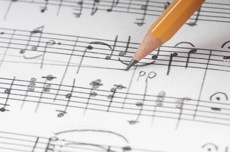 music notes background: Sheet sheet and pencil, shallow DOF