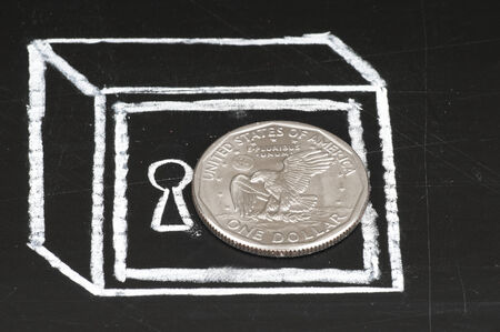 Dollar coin and drawn on a chalkboard safe. Save money concept . photo