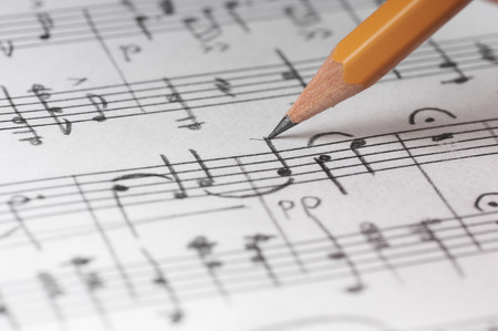 music background: Sheet sheet and pencil, shallow DOF