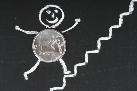 financial growth concept - cheerful coin runs up the stairs , drawing with chalk photo