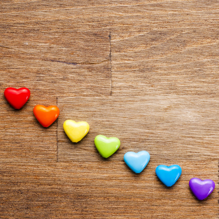Bright hearts on wooden background Stockfoto