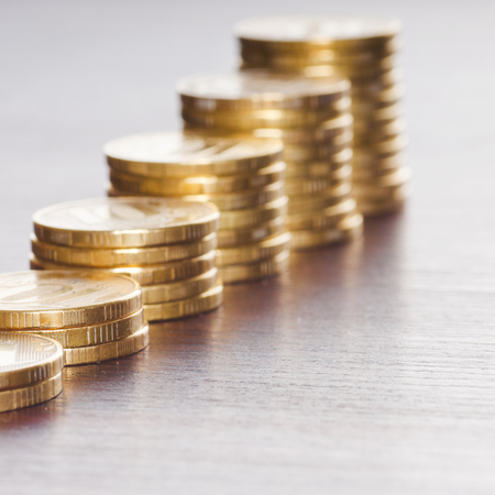 rows of gold stack coins photo