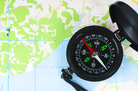 magnetic north: compass over topographic map Stock Photo