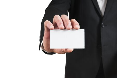 Blank business card in a businessmans hand photo