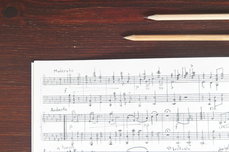 Music notes and two pencils on table Archivio Fotografico