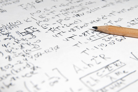 sheet of paper filled with calculations of nuclear and quantum physics as a background Stockfoto