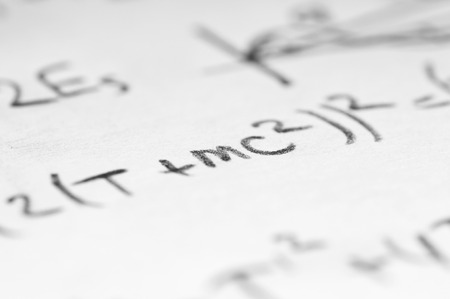 quantum physics: sheet of paper filled with calculations of nuclear and quantum physics as a background Stock Photo