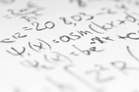 physics background: sheet of paper filled with calculations of nuclear and quantum physics as a background Stock Photo