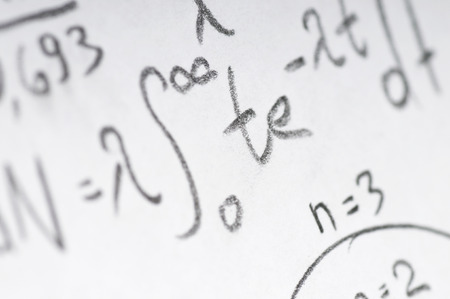sheet of paper filled with calculations of nuclear and quantum physics as a background photo