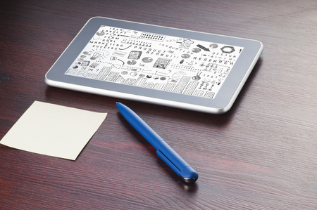 doing business: Tablet PC with the scheme of doing business on the screen on the desk Stock Photo