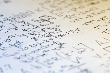 sheet of paper filled with calculations of nuclear and quantum physics as a background Banco de Imagens