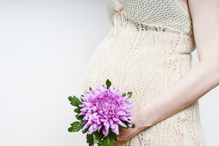 birthing: pregnant woman with flower