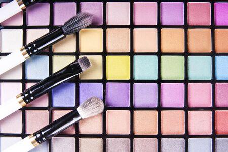 eye shadows: make-up brushes on colorful eye shadows palette Stock Photo