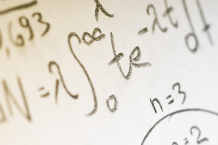calculations: sheet of paper filled with calculations of nuclear and quantum physics as a background Stock Photo