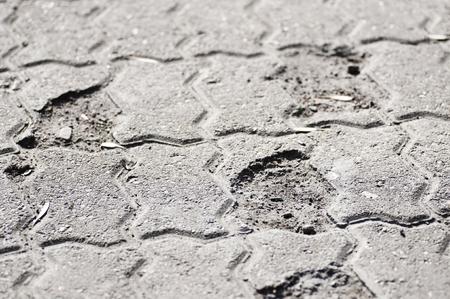 paving: Broken substandard paving slabs