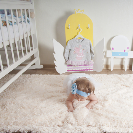 designer baby: Baby girl playing at home or kindergarten Stock Photo