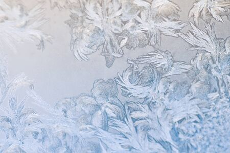buildup: Frosty winter background photo of ice buildup on a window