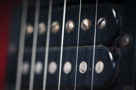 De pickups op de oude elektrische gitaar Stockfoto