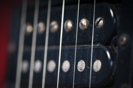 The pickups on the old electric guitar