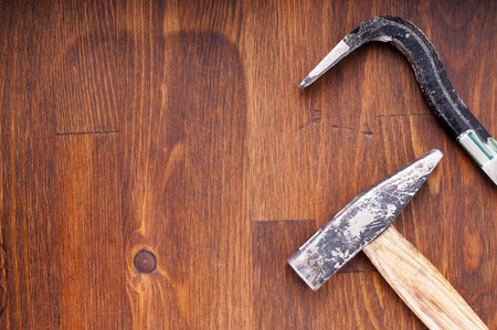 Hammer and nail puller on a table. Old tools Stock Photo