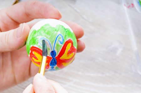 Easter egg painting with acrylic paints