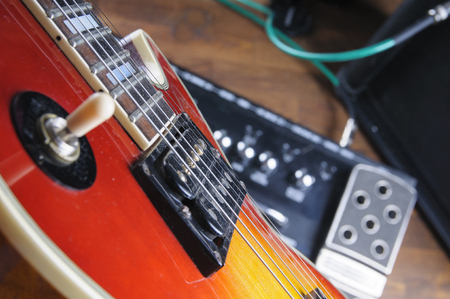 Guitar and digital guitar stompbox. The view through the eyes of a guitarist