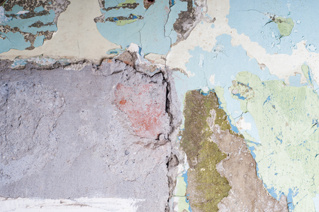 Old wall with many layers of peeling paint Imagens