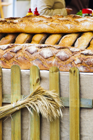 Fresh crispy bread lies on the counter at the traditional street fair in Europe