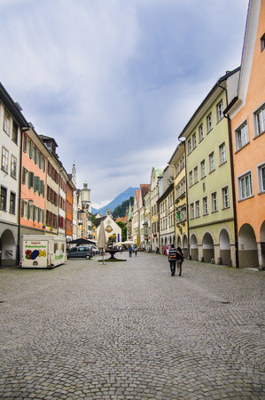 FELDKIRCH, AUSTRIA - SEPTEMBER, 18, 2014: Residential and commercial houses in the medieval part of the European city in the Alpine mountains