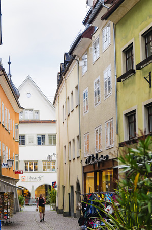 FELDKIRCH, AUSTRIA - SEPTEMBER, 18, 2014: Streets, residents and tourists in a small mountain European city