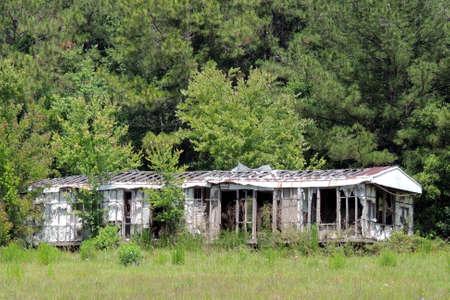 decrepit: Abandoned trailer in rural area