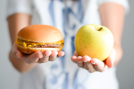 met: Choose between junk food versus healthy diet Stock Photo