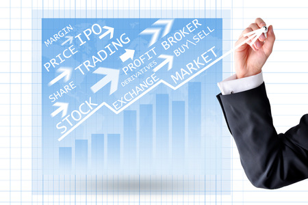 Stock exchange panel with businessman hand drawing a graph with arrow