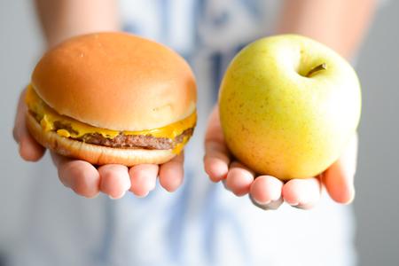 Choose between junk food versus healthy diet Stock Photo