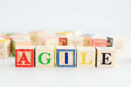 "Wooden letter blocks forming the word ""agile"""