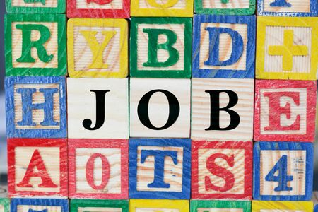 remuneration: Job search with wooden letter cubes concept