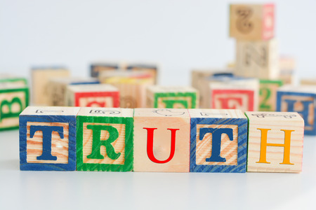"The word ""truth"" spelled with wooden letter cubes Stock Photo"