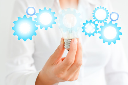 Business innovation concept with light bulbs and spinning gears