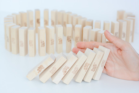 Stopping the domino effect concept with a business solution and intervention Standard-Bild